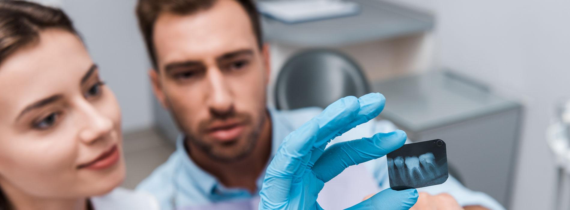 Dentists examining a teeth x-ray