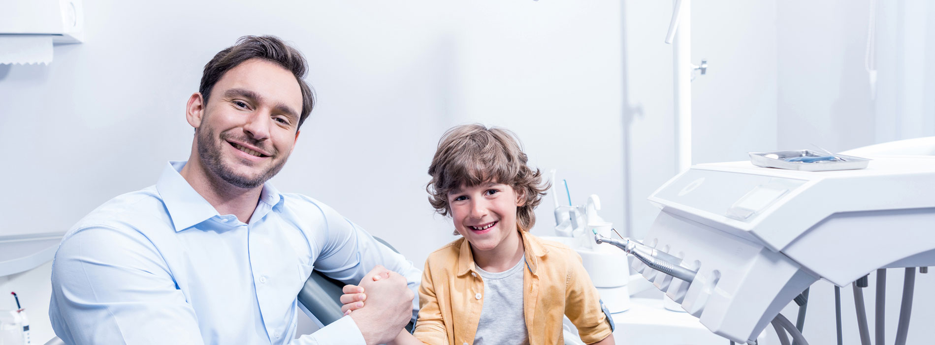 Dentist smiling with a kid