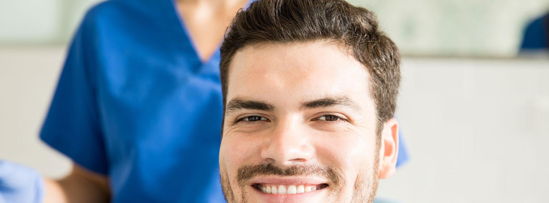 Man smiling at the dental