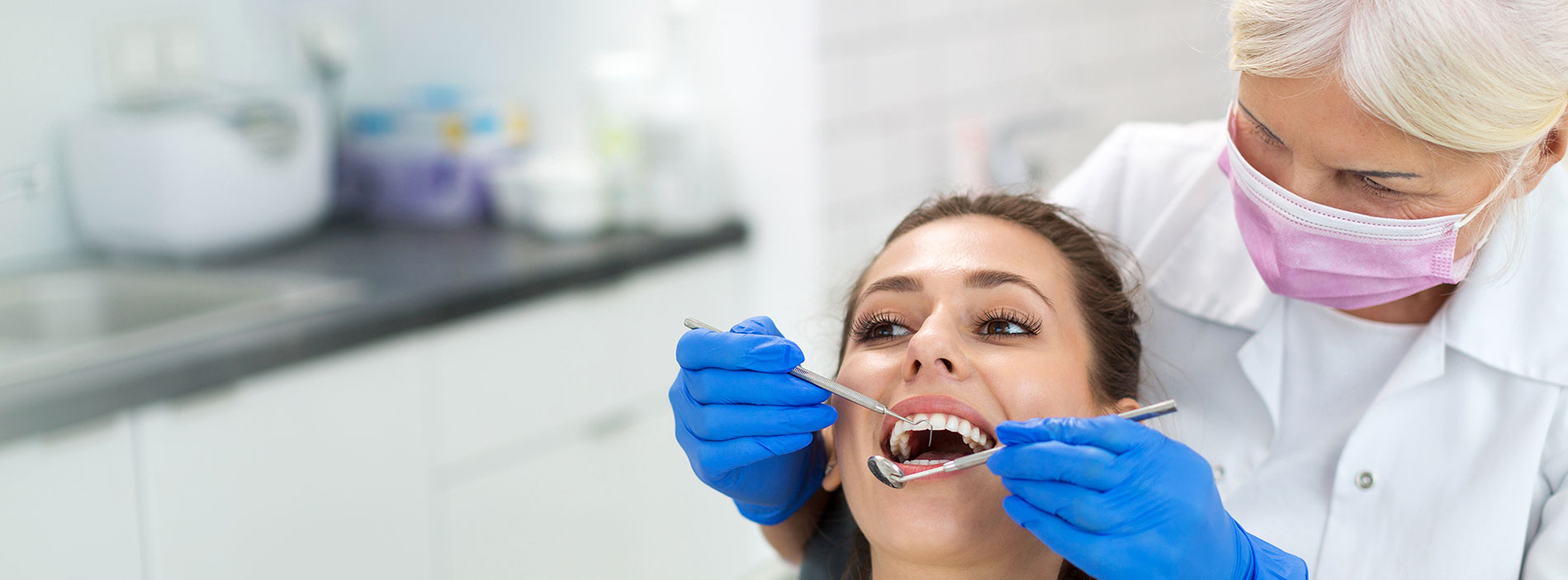 Woman having dental checkup at dental clinic