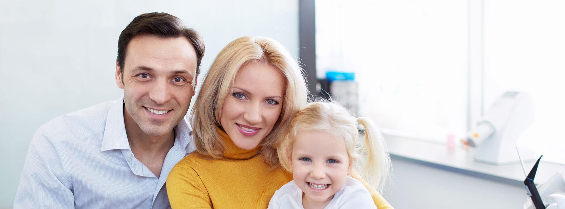 Beautiful family smiling at dental