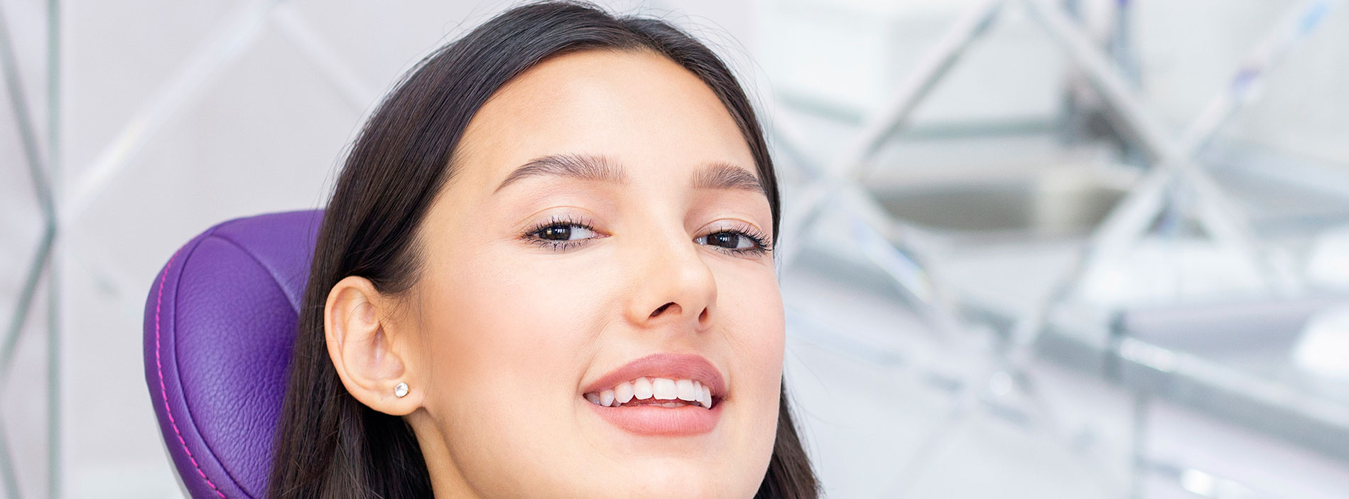 Woman smiling with the implant retained dentures