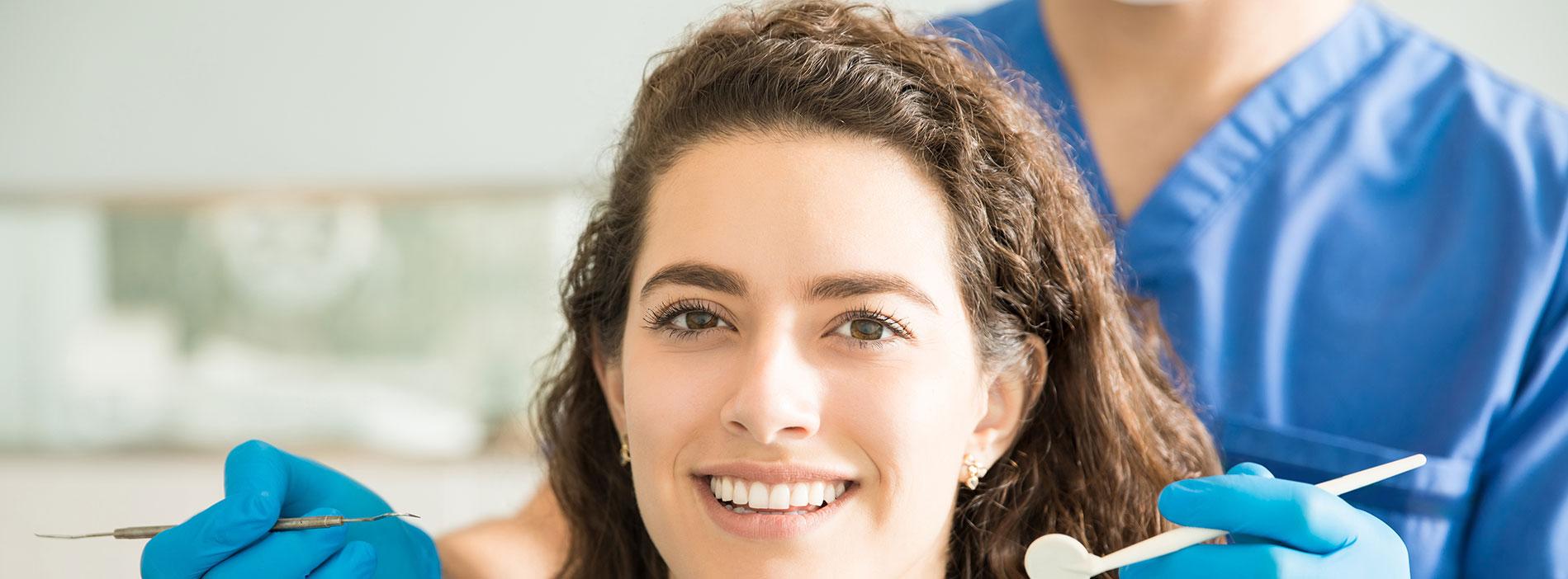 Woman smiling with the dental veneers
