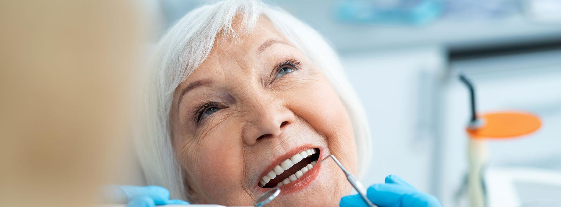 Senior woman smiling with dentures