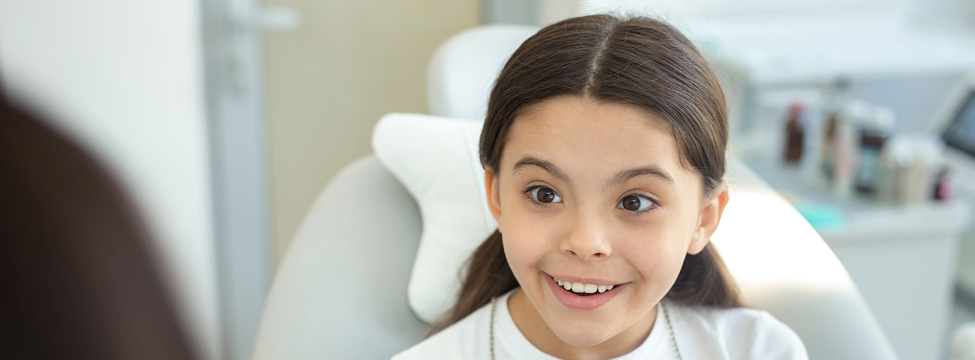 Kid smiling at dental clinic
