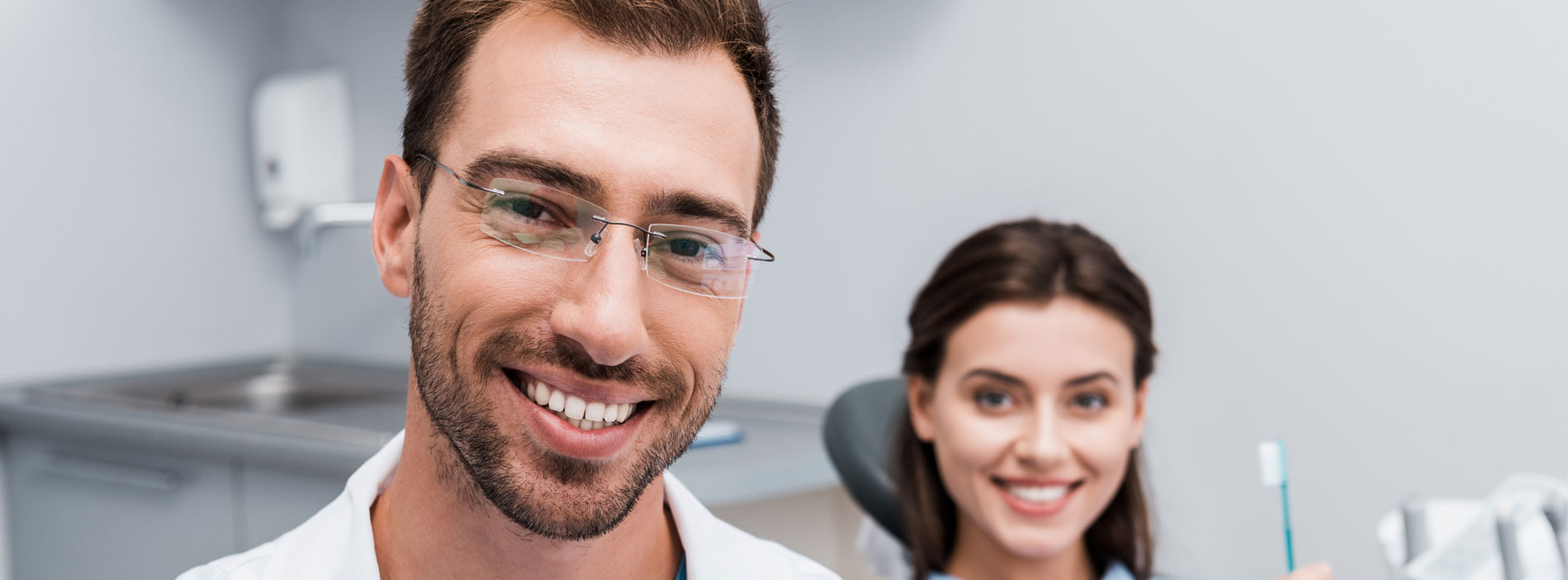 Dentist and patient smiling