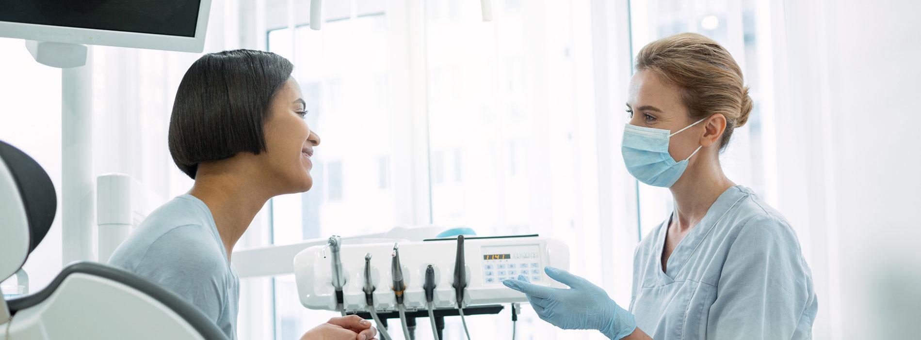 Dentist an patient at dental