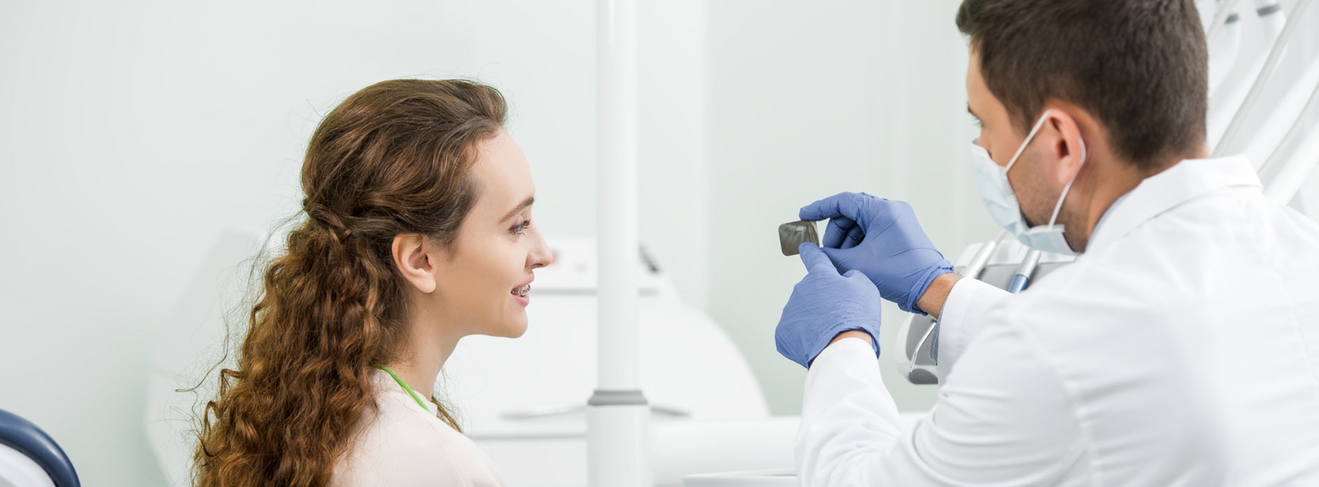 Dental showing x-ray report to patient