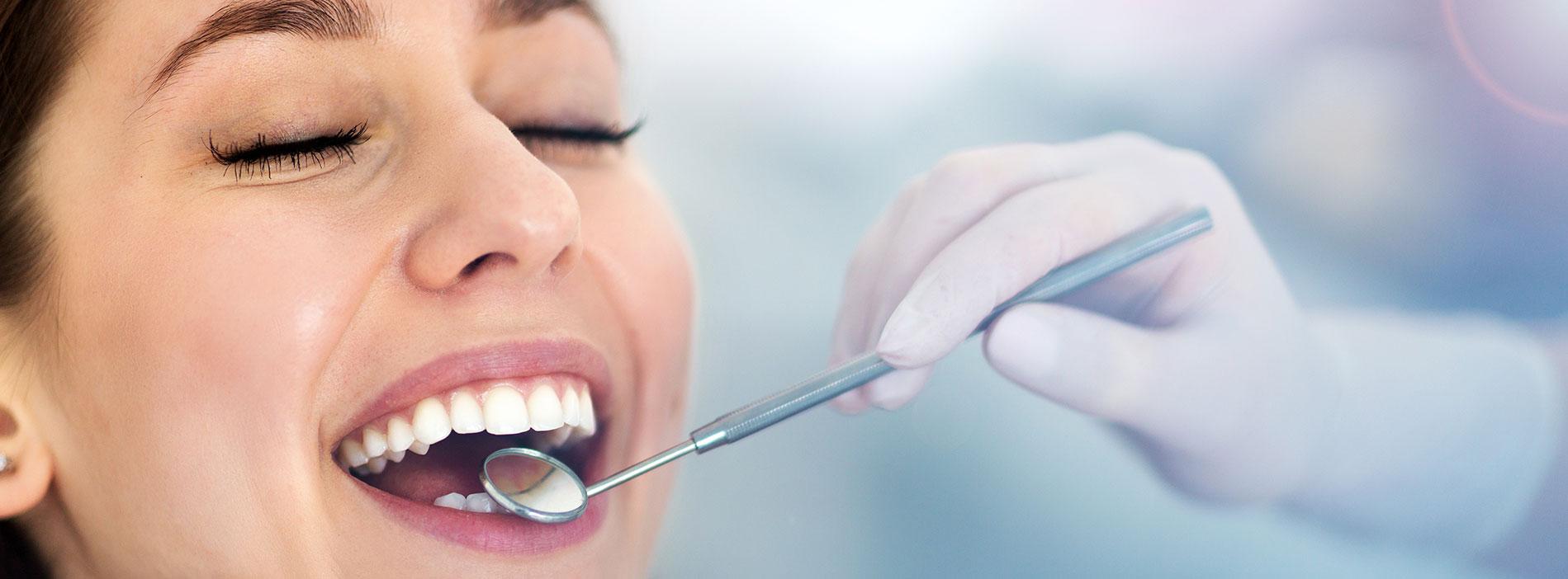 Woman smiling at dental